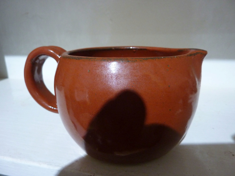 small pouring vessel marked JF 00117