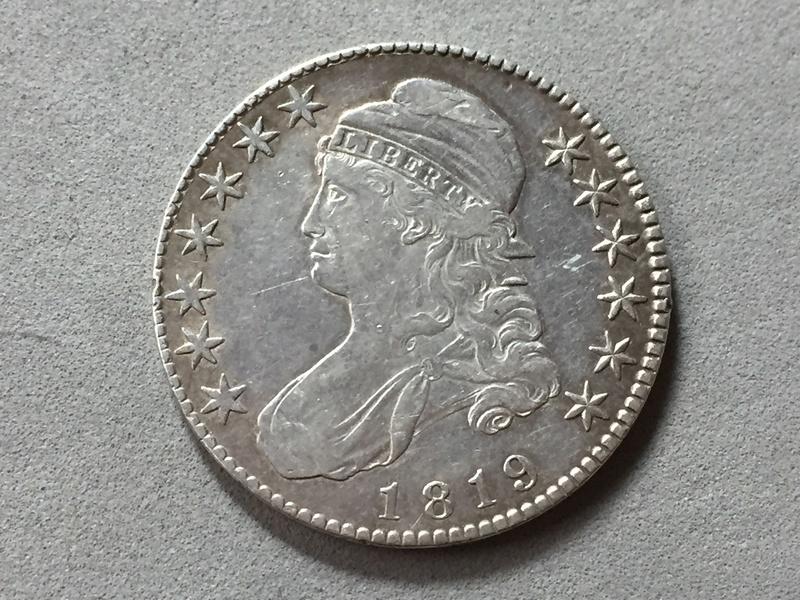 Medio dolar 1819 . Img_6916