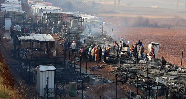 ضحايا في حريق مخيم للنازحين السوريين في لبنان I10