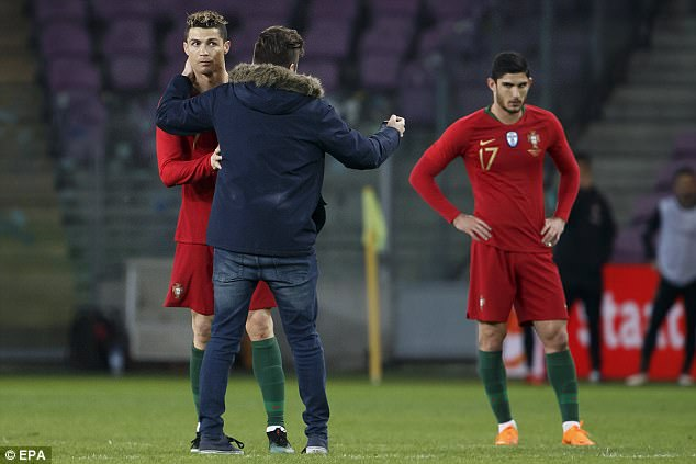 Cristiano Ronaldo kissed by excited pitch invader 4a94b210