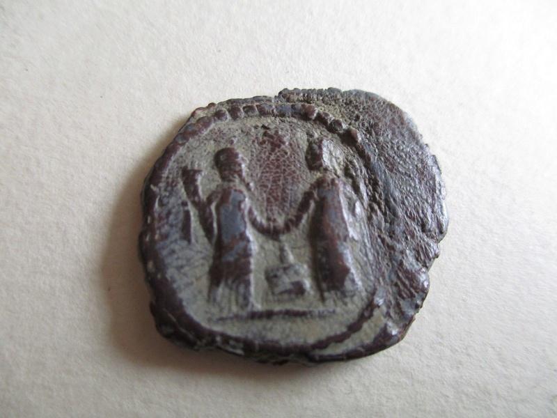 Ayuda para identificar esta moneda S-l16012