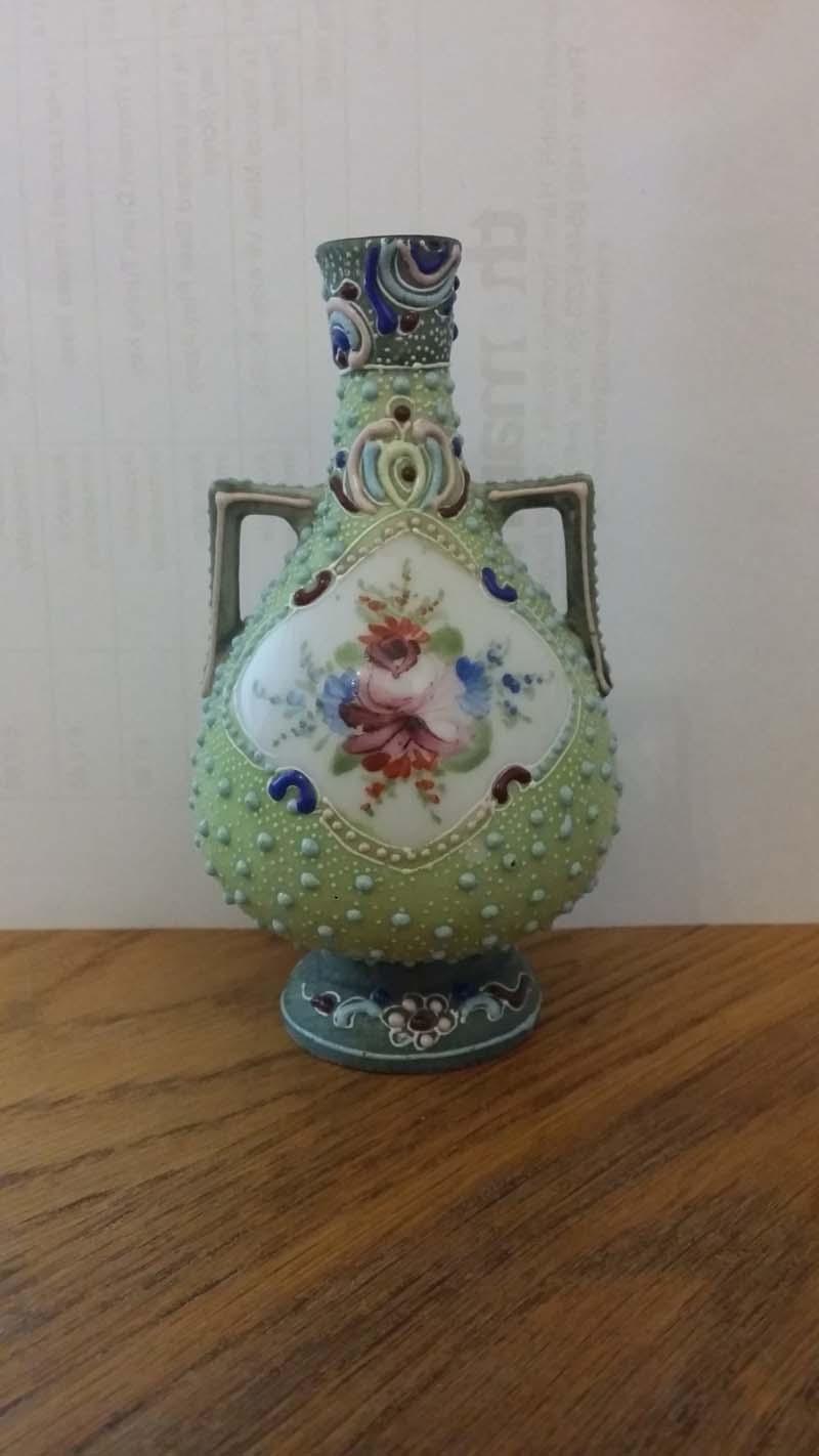 Identifying small green studded stem stem flower vase  Flower11
