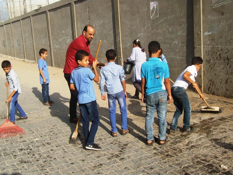 انطلاق فعاليات تطوعي لتنظيف شوارع dscf2515.jpg
