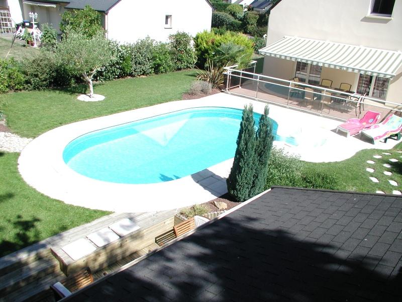 Evolution du jardin quelques années après la construction de la piscine - Page 2 P6260018