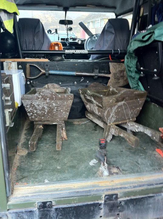 You can get two wheelbarrows in a back of a Landrover 90 18836610