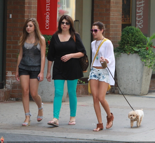 June 19 - Walking out her dog Maui in Toronto with friends Norm1278
