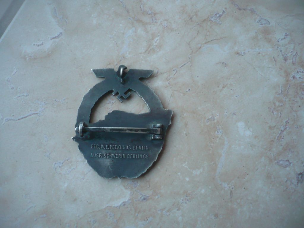 badge kM P2610340