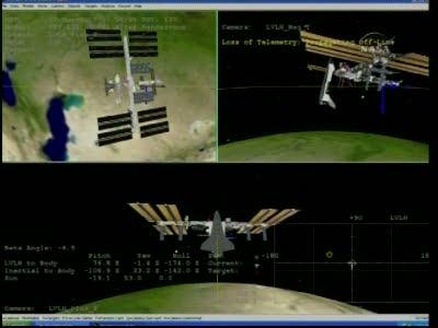 [STS-132] Atlantis : EVA 1, Reisman et Bowen. Vlcsn729