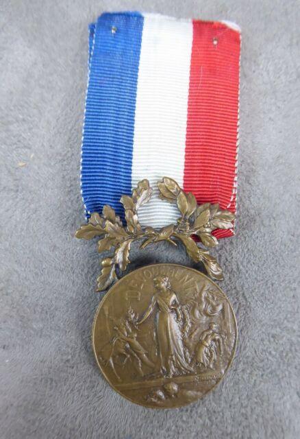 Identification des médailles S-l64011
