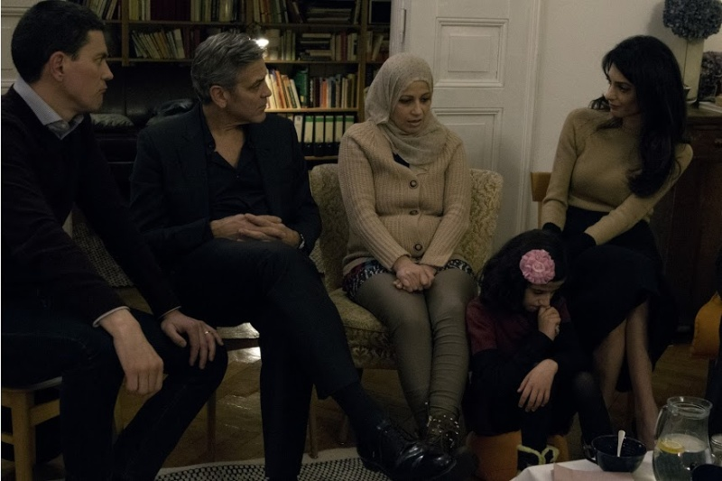 George Clooney and Amal meeting with Refugees Cloone13