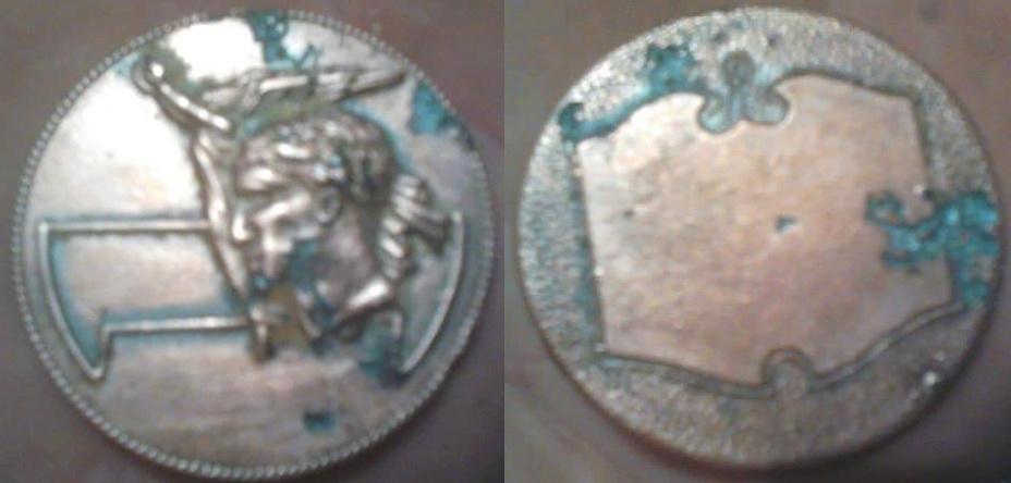 ¿ Esto es una Medalla ?.  Identi10