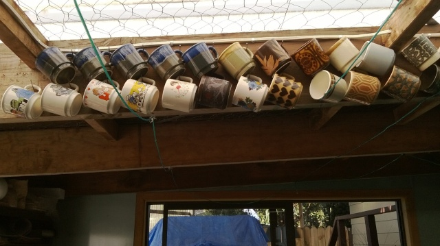 Cups and Mugs hanging in the rafters! Cups110