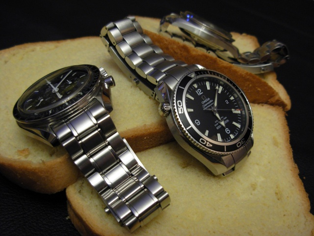 Mon Omega Planet Ocean 2201 50 00 - Page 7 Tranch10