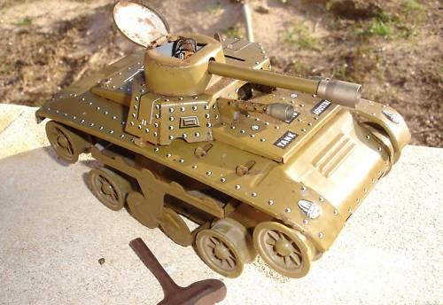 Les jouets militaires en tôle, plastique ou bois. Beilgj10