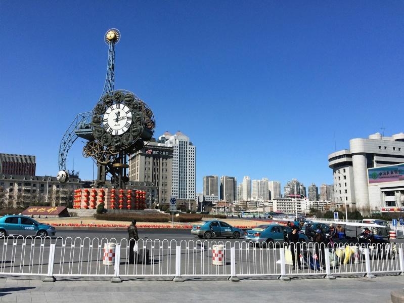 Reçu un beau diapo....Les horloges et pendules des rues..... - Page 5 Tianji11