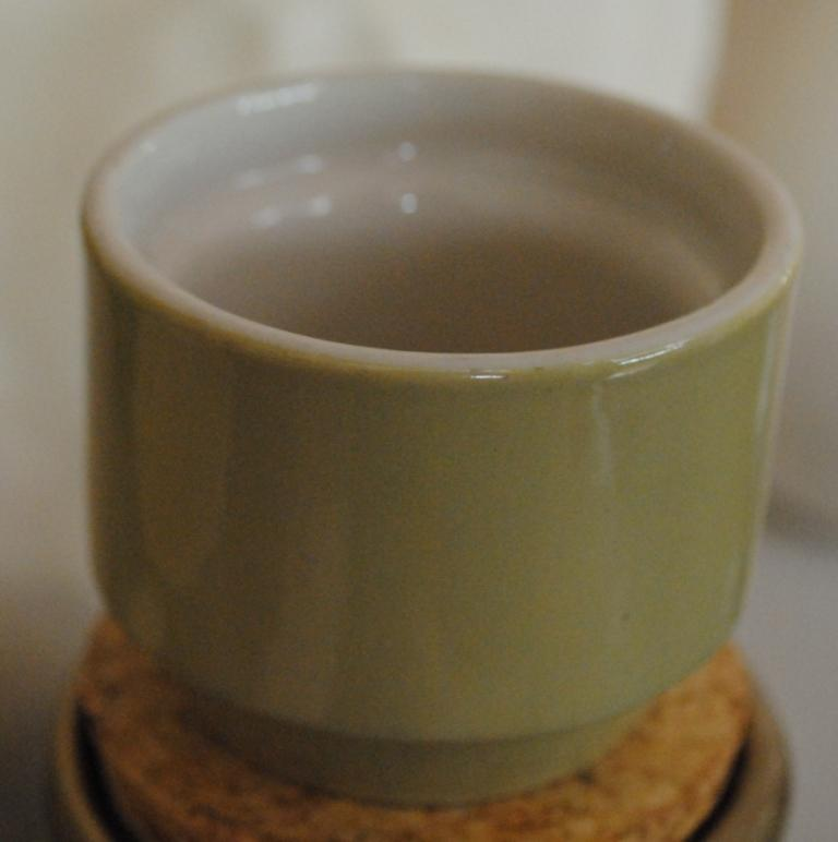 A little mustard pot minus it's lid .... is a vitrified egg cup Possib10
