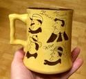 Widecombe Fair slipware mug - Devon Tors Pottery, Bovey Tracey Image292