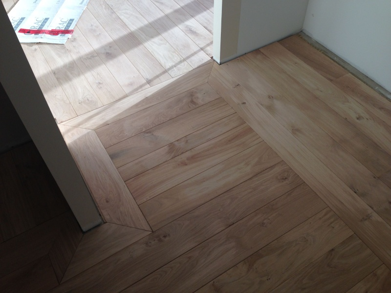 Pose d'un parquet chêne collé sur plancher chauffant Img_4311