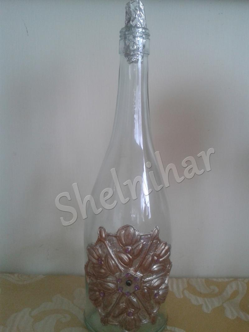 Botella decorada con repujado de Shelnihar K3an1110