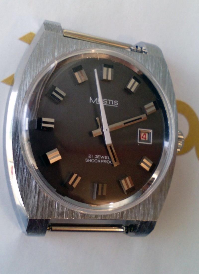Marques d'emprunt ou d'exportation des montres soviétiques - Page 2 Mestis10