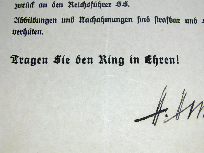 Comment peut bien valoir la signature de H Himmler ? 51217d10