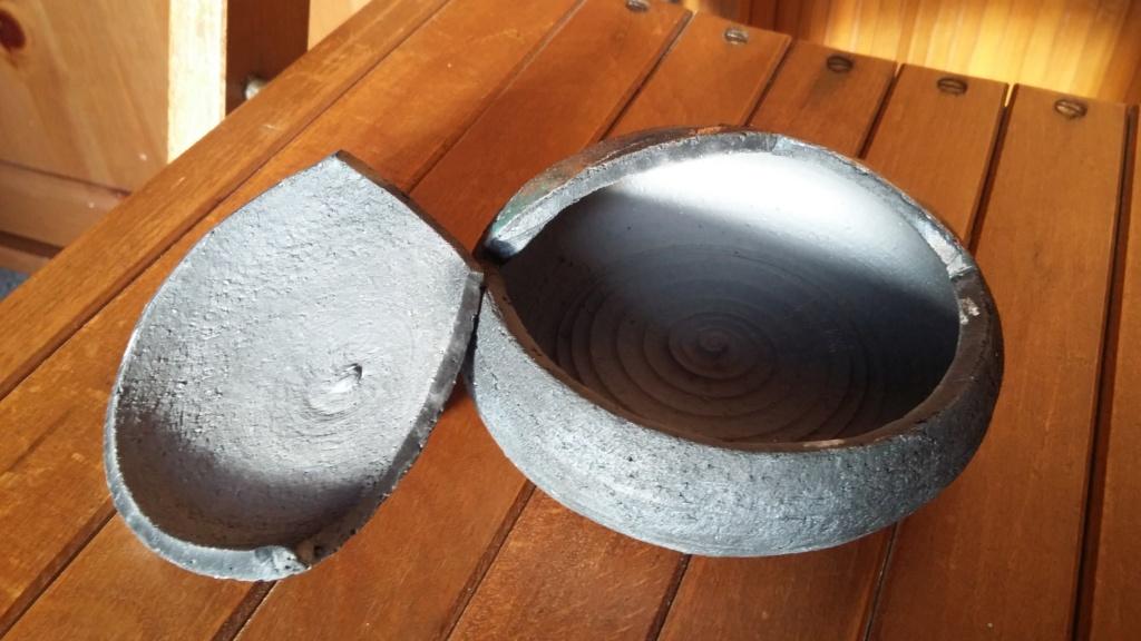 Small lidded dish some iridescence to glaze dark ceramic signed T. T ..L? 20190114