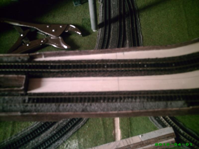 faire un muret le long de la voie ferree Mur910