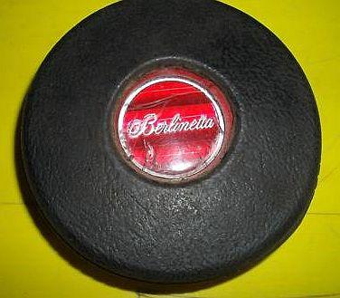 is this a laguna 4 spoke horn button emblem? Button12