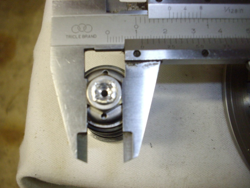 What size nut is used 4 fork compression/rebound shim stack? 012-310