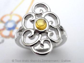 Bague tourbillonnante argent avec un saphir jaune cabochon Baac9512