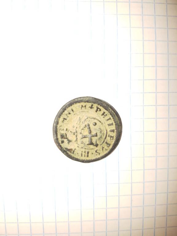 Acerca de esta curiosa moneda 113