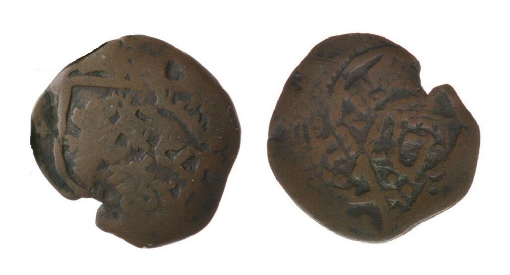 8 maravedís de Felipe III o IV acuñados en Madrid, resellados. 211