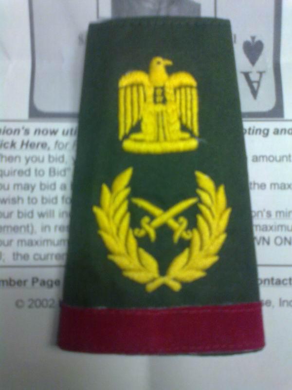Saddam Hussein shoulder boards & cord,real or fake? Sh510
