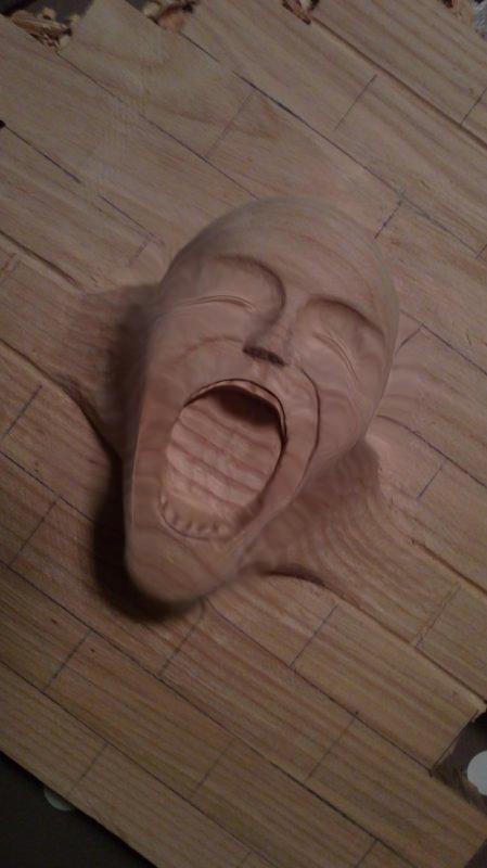 petite question sur un visage en bois 211