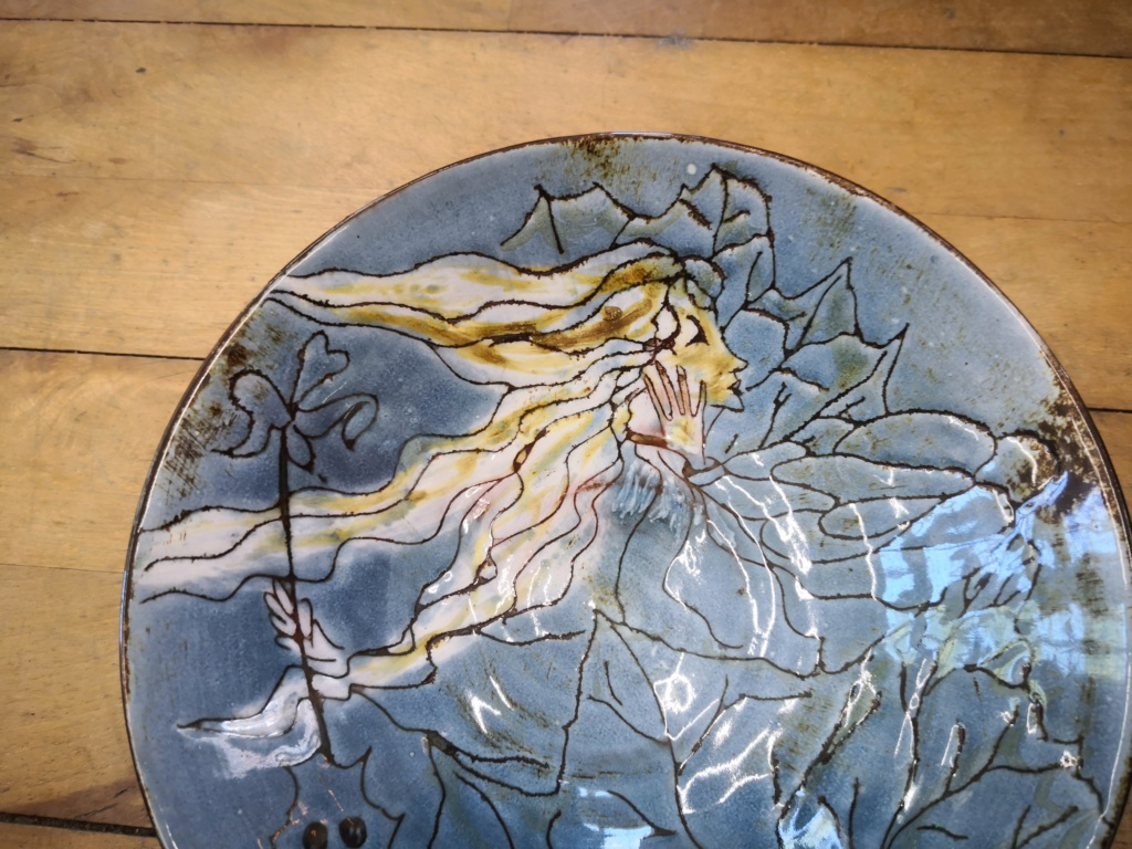 Blue high glaze bowl with women's face Img_2051