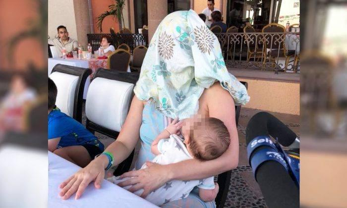 Après qu'on lui a demandé de «couvrir» son bébé, la photo d'une maman qui allaite devient virale 61560310