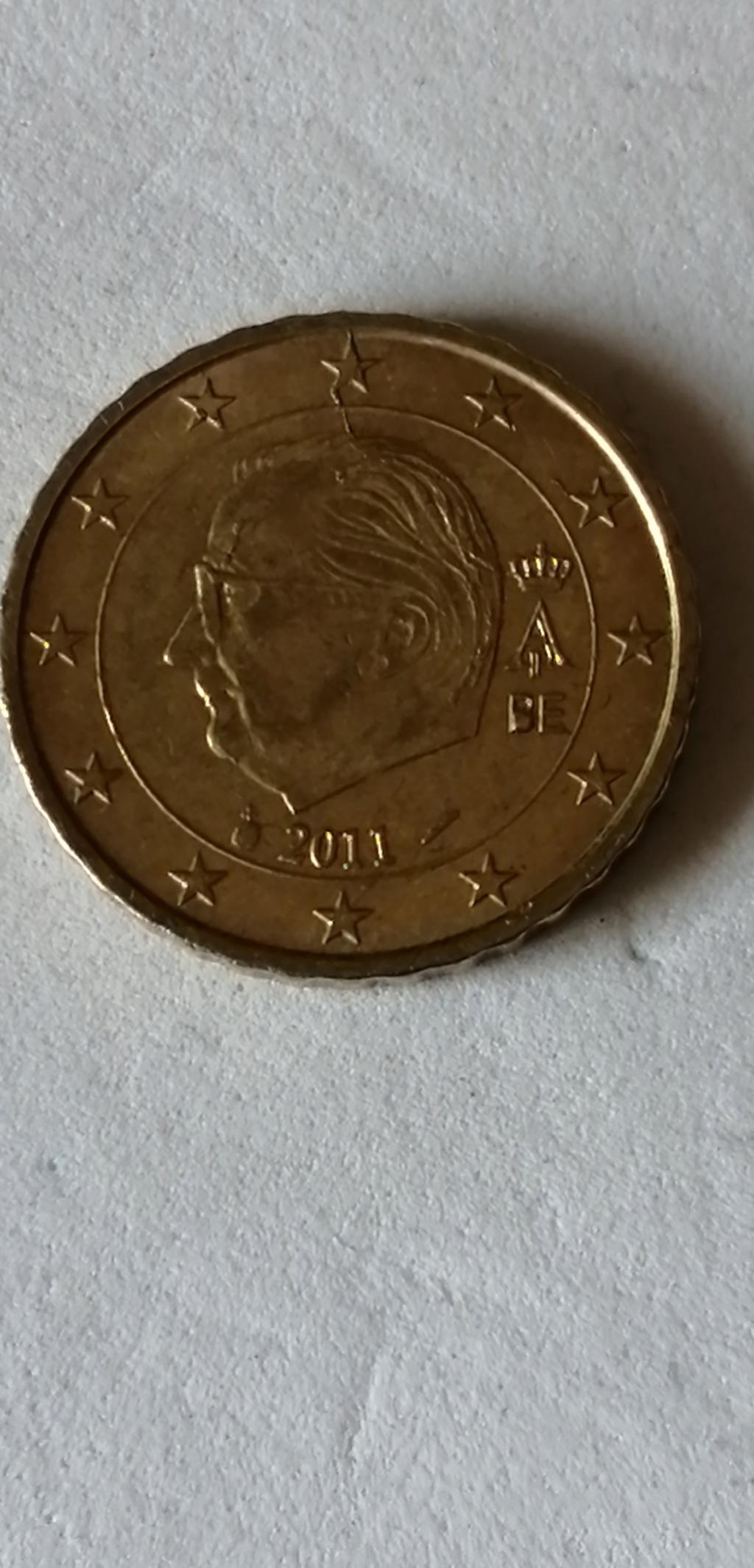 Rotura de cuño, exceso de metal 10 cts Bélgica 2011 Belgic11