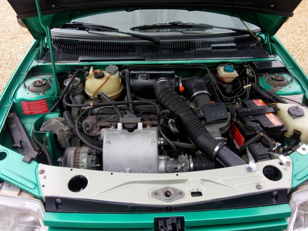 [18] 205 GTI Griffe - 130cv - AM 91 - Vert Fluorite Img_2011