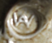 Where have I seen A over W before?  Not NZ pottery, it's Malaysian. Whelda10
