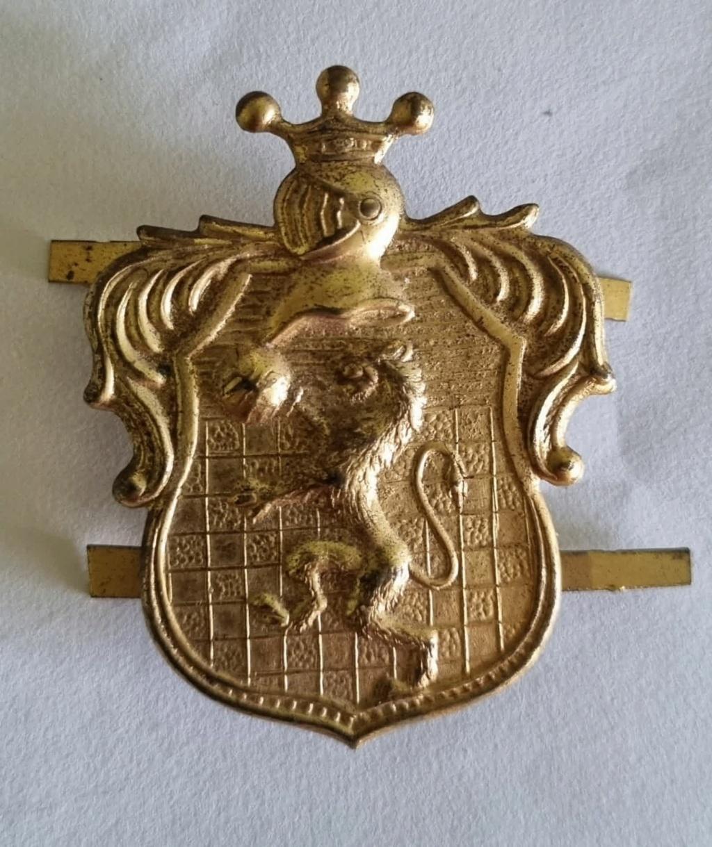 Identification de cette plaque ou insigne en taule emboutie  20210341
