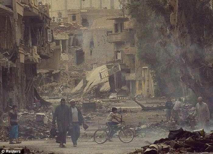 Lufta civile në Siri, pamjet e rralla të shkatërrimit nga bombardimet (FOTO) Siri511