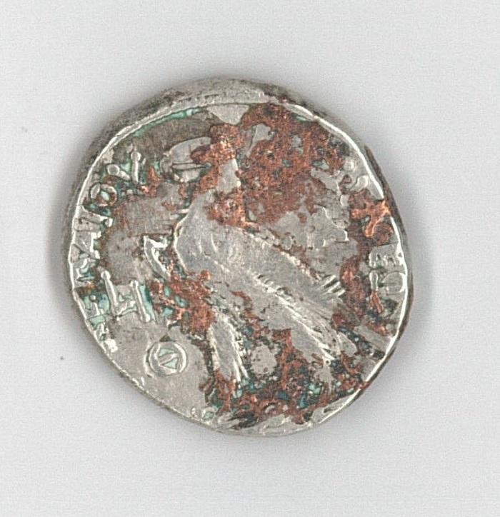 Etrange métal fondu sur monnaie argent Numism10