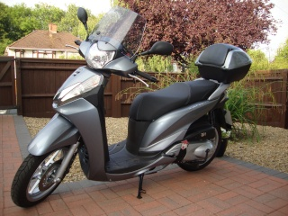 Honda sh 300i long term review. Dsc03428