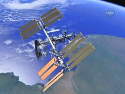"""""""Photo de famille"""" Photo d'ISS avec une navette arrimée. 11stat10"""