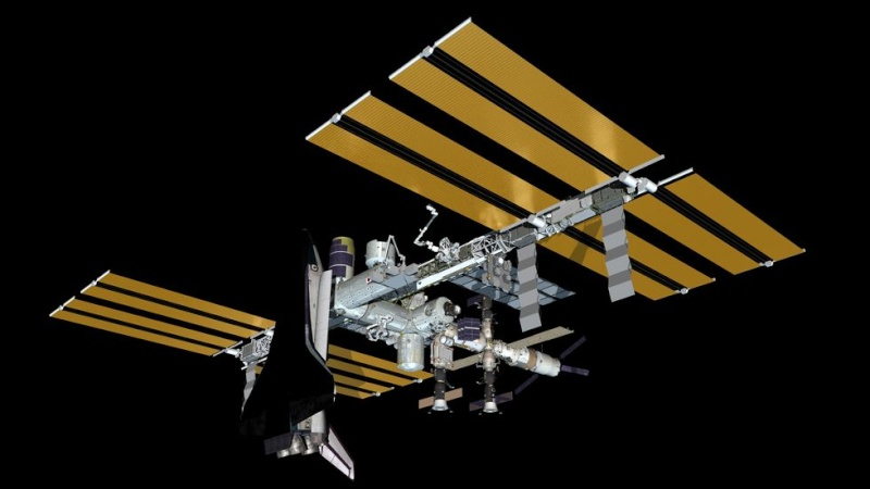 """""""Photo de famille"""" Photo d'ISS avec une navette arrimée. Test10"""