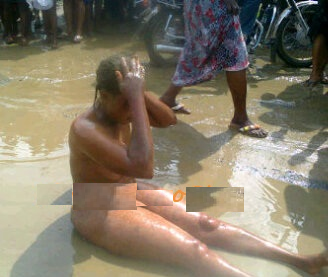 A food Vendor runs mad on the street naked after confessing to using mutuary water to get customers Seller11