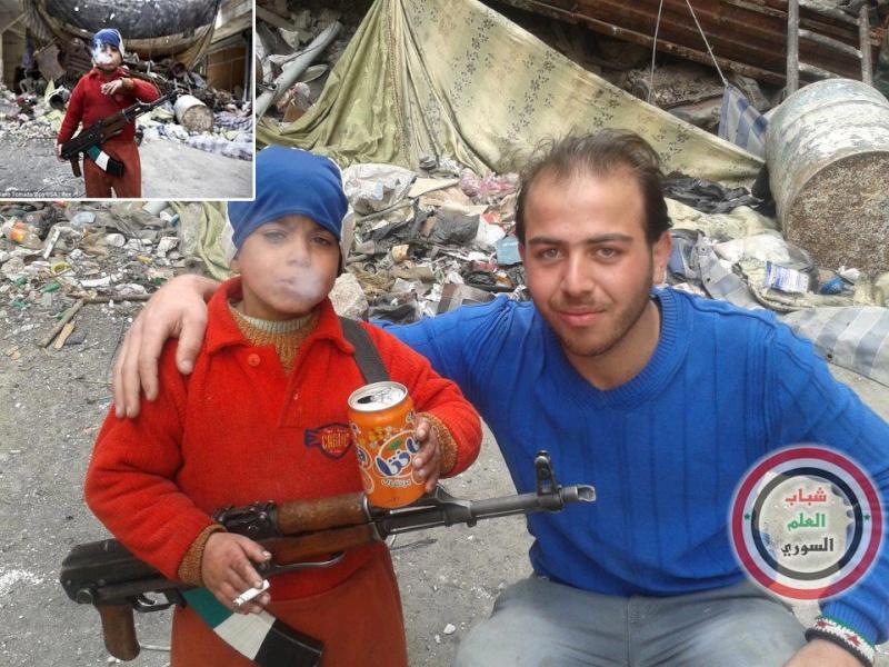 الصهيونية و الوهابية التكفيرية  تعلمان الأطفال القتل و الإرهاب و العنصرية  71448_10
