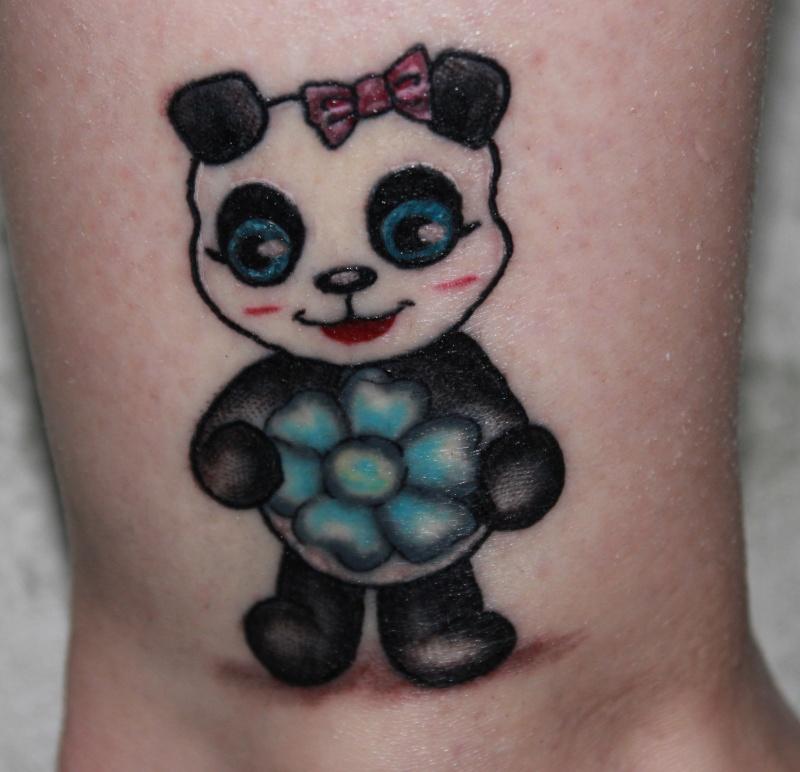 Avez-vous un persing ou un tatouage? Pandin10