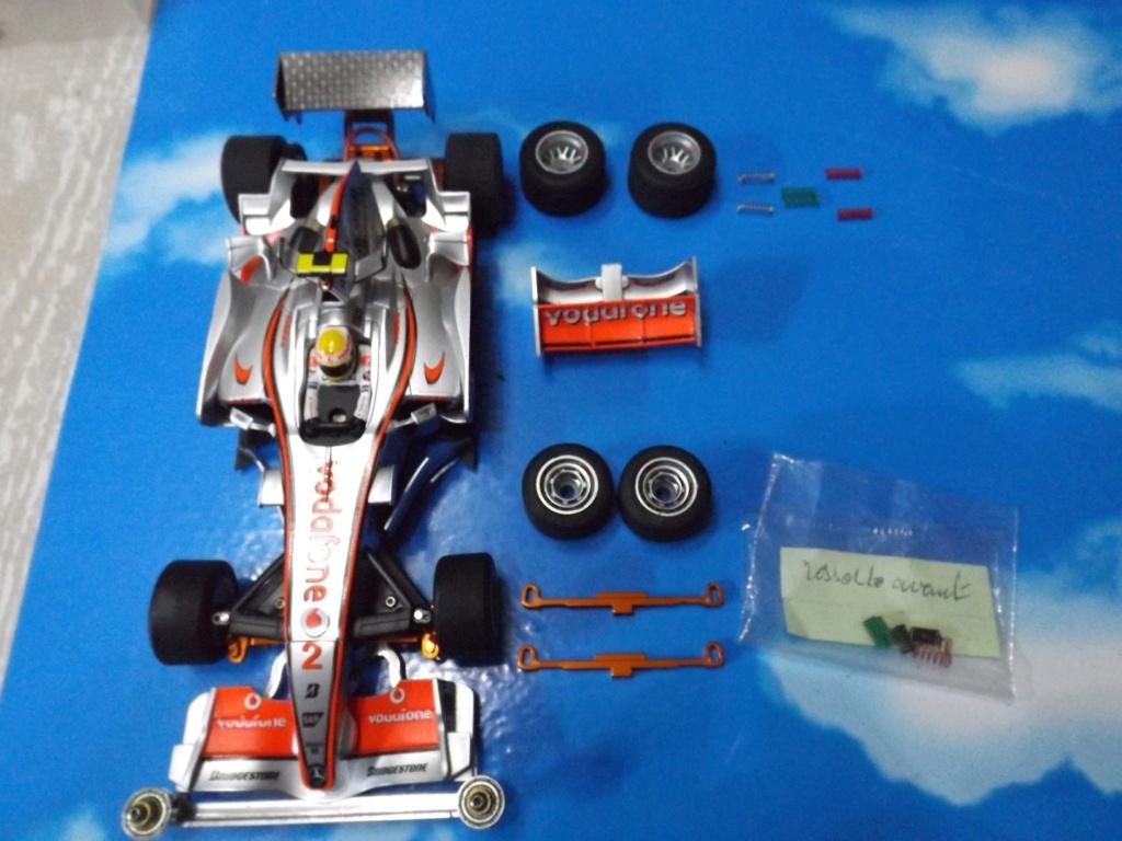 vend une F1 2,4Ghz optionnée pour la compétition et plein de piéces détachées neuves  Dscf5441