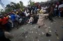 Le Matin:Des milliers de partisans de Jean-Bertrand Aristide devant le palais de 21537012